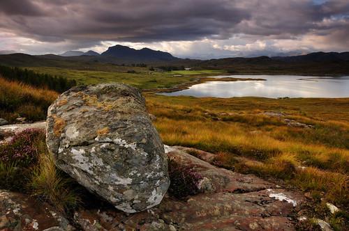 sea sky cloud mountain mountains water grass rock clouds landscape scotland highlands rocks purple outdoor boulder formation serene geology drama westerross ewe inverewe scottishhighlands erratic poolewe lochewe isleofewe