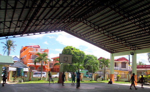 Basketball players in the newly-rehabiltiated General MacArthur Civic Center | by dilg.yolanda