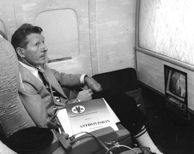 Actor Danny Kaye in First Class on American Airlines with TV in 1964 Los Angeles, California