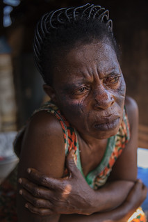 Rebecca Okutu listens to a family member talk about LEAP (Livlihood Empowerment Against Poverty) | by World Bank Photo Collection