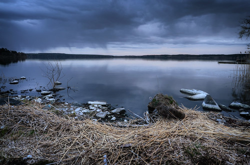 trees sky nature grass clouds reflections landscape evening rocks mood moody cloudy sweden stones horizon sverige vignette hdr waterscape mälaren sigtuna