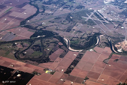 vacation river energy texas flight aerialview aerial airline unitedairlines windowseat texasamuniversity oilgas oxbowlake brazosriver riversidecampus wellheads pointbars zeesstof phoenixtohouston fluvialprocess