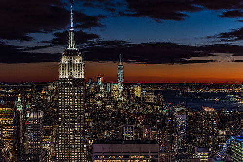 city sunset orange newyork rock night us cityscape unitedstates state top empire