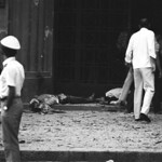 Result of one explotion on Tu Do street and the beheaded body of Vietnamese bystander lies on the sidewalk. June 1968.