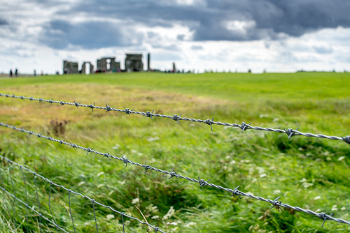 uk blue england white plant black color green art monument field grass clouds landscape photography grey photo nikon unitedkingdom bokeh outdoor colorphotography stonehenge barbedwire gb salisbury wiltshire grassland prehistoric bronzeage neolithic amesbury nikond600