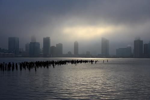 nyc newyorkcity light sunset shadow fog skyline river cityscape hudsonriver hudson pilings westside piling pier32 reprocess njskyline reprocessed whatusedtobe canon40d
