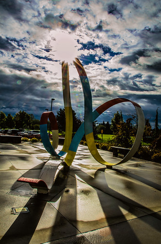 sculpture clouds shadows dramatic surrey flare sunburst hss martinsmith southsurrey nikon18200mmvrii nikond7000 happyslidersunday ©martinsmith southsurreyrecreationartscentre