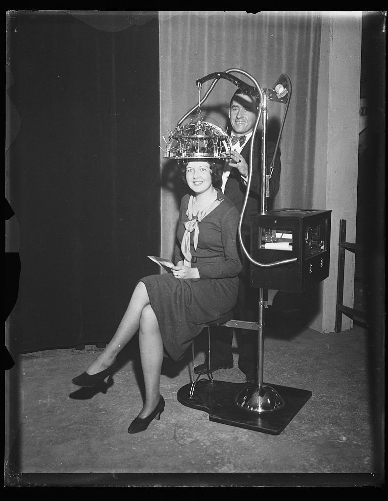 Identified! [Woman seated with a psychograph, a phrenology machine, on her head] (LOC)