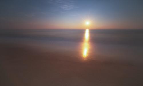 goldenhour sunrise calm serene water minimal starburst smooth calming sun minimalism longexposure dreamy layers pretty tones beach light sunny bright sony a7r zeiss