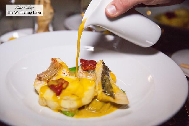 Second service of Bouillabaisse - rich saffron broth, rockfish fillets, tomatoes