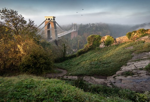 uk morning bridge autumn trees england sky sun sunlight mist colors leaves birds misty fog architecture zeiss sunrise river bristol early flying woods colours suspension outdoor sony tide foggy first changing serene fe leigh kissed za avon clifton f4 autumnal foreground oss 1635mm a7r ilce7r