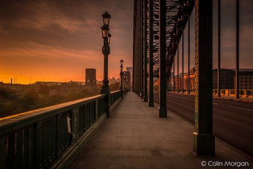 bridge gateshead newcastle newcastlegateshead rivertyne sky stmarysheritagecentre streetlight sunrise thesage tynewear tynebridge yellowsky orangesky architecture road pavement