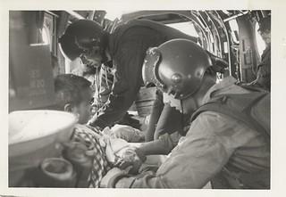 Marines Load Vietnamese Children into Helicopter, December 1966