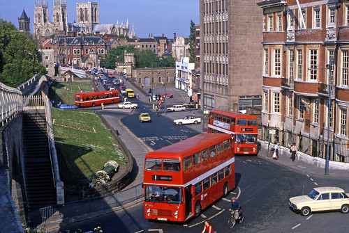 11895 (848) York Corp Bristol VRT-SL36-LXB VRT-SL3 FWR 218T (3721), Bristol VRT-SL3 6LX VRT-SL3 RWT 545R (fleet No 3970) and a Leyland National with Yorkminster Cathedral overlooking in Museum Street, York, England, United Kingdom.