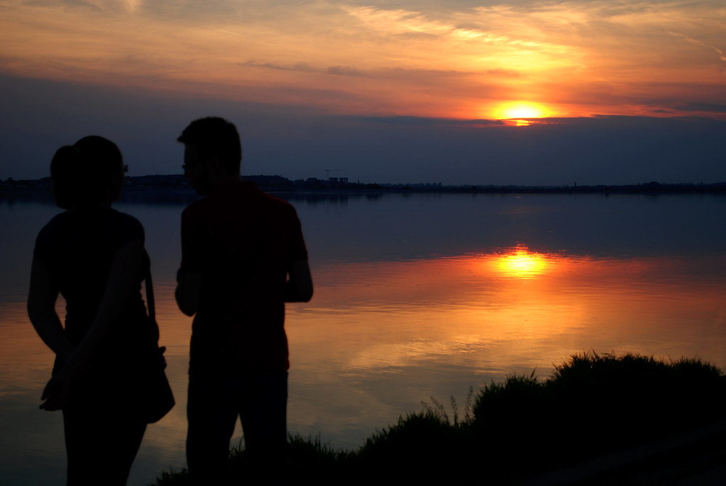 Silhouette of a Couple Watching the Sunset