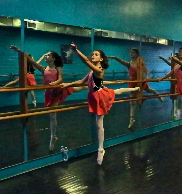 Young Ballet Dancer's Arabesque At The Barre