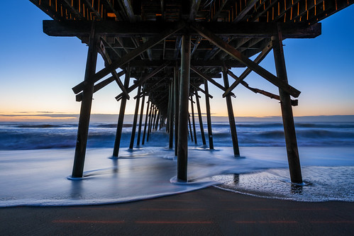 kurebeach kurebeachfishingpier northcarolina water travisrhoadsphotography copyright2016 thebluehour sunrise dawn waves ocean nikcollectionbygoogle landscapephotography flowingwater fishingpier coastal beach rrspcl01 reallyrightstuff gitzogt2830basaltseries2 canonef1740f4l sonyilce7rm2a7rii metaboneseftoeivt 2016