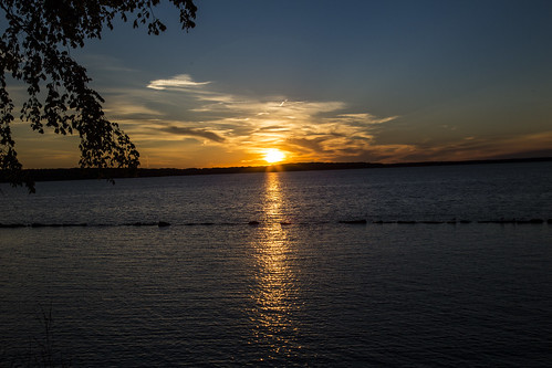 light sunset sky orange sun lake water leaves clouds ray pennsylvania pymatuning