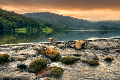 trees light sunset england orange lake reflection green water landscape flow evening moss rocks day stones grasmere lakedistrict overcast cumbria flowing tranquil