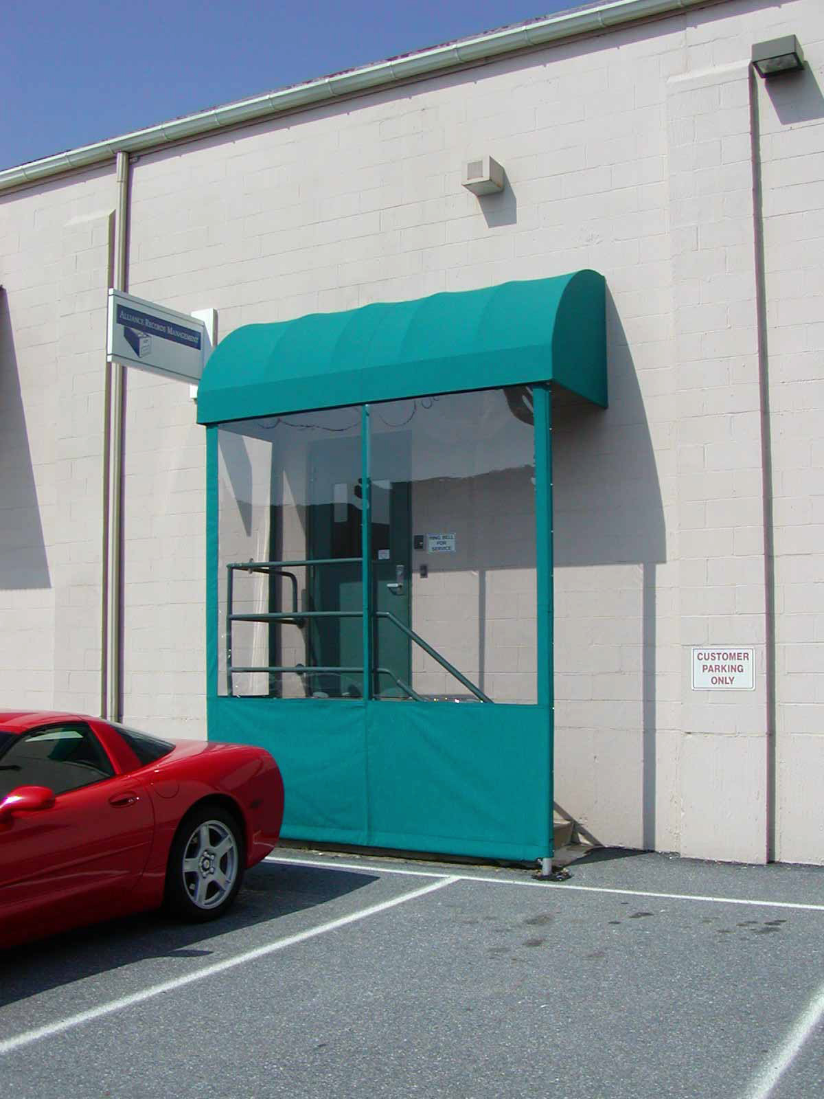 Awning with wind barriers