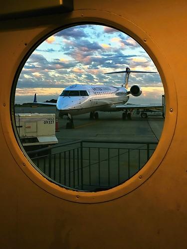 desmoines unitedexpress airplane airport window tarmac sunset clouds