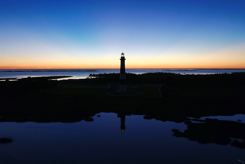 blue light sunset sea sky usa lighthouse color reflection water silhouette night outdoors photography outdoor northcarolina aerial bluehour outerbanks goldenhour obx crepuscularrays drone bodieislandlighthouse bodieisland 2015 dji inspirephotos photosbymch 400tripod