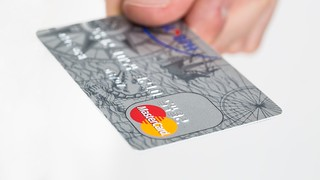 Credit card on a white background | by cafecredit