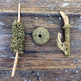 Yesterday's effort. Driftwood and hemp and dried lichen. Shot on a timber table I found on the side of the road after the flood of 2013, covered in river silt. #sculpture #sculptureart #crochet #hemp #driftwood | by gooseflesh