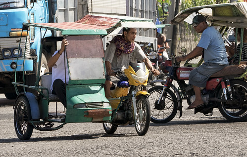 city traffic tricycle taxi philippines riding rush hour bacolod sidecar