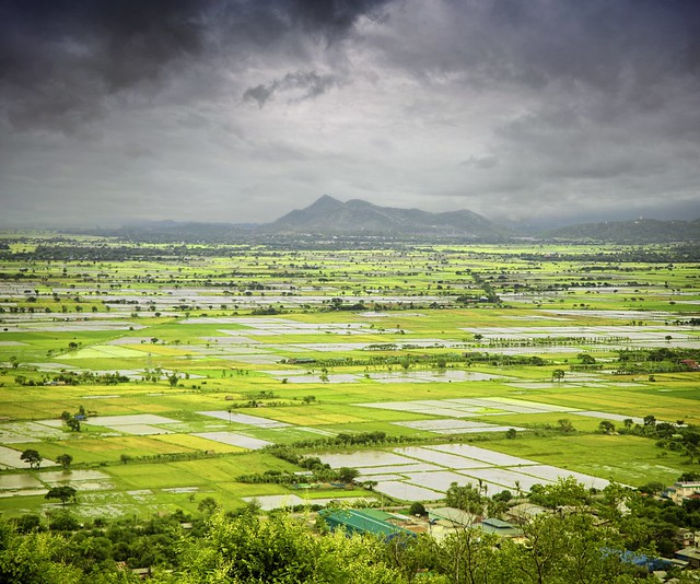 Mandalay Hill surrounded by mountainous plains and rice terraces