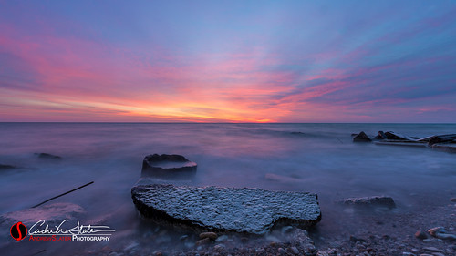 longexposure nature water wisconsin clouds sunrise canon landscape us rocks waves unitedstates horizon lakemichigan shore lakefront kenosha landscapephotography discoverwisconsin southportpark travelwisconsin 5dmarkiii andrewslaterphotography wicounties