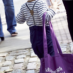We start them early... | A wee boy carries a large haul of books out of the Festival © Helen Jones