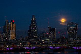 Moonrise over the city.   by Owen Llewellyn