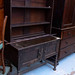 Ornate dark wood stained 2 door storage unit