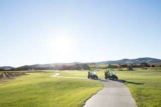 Two golf carts on the path | by winecountrymedia