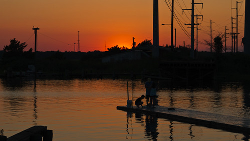 orange silhouette reflections fishing telephonepoles