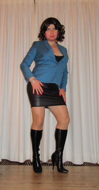 wetlook skirt with boots, nylons and a jacket