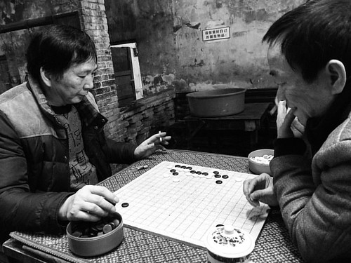 people in the tea house, playing Go. #travel #teahouse #people #streetphotography #boardgame #china #city | by PhotoSino