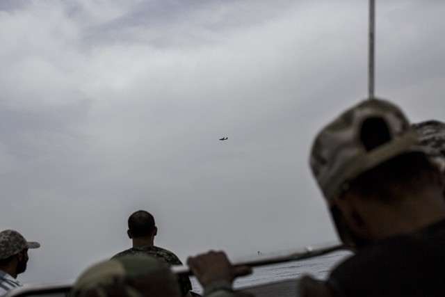 Surveillance operations carried out by NATO aircraft and the Libyan coastguard in the Mediterranean Sea looking for the boats of migrants. Libyan Sea.