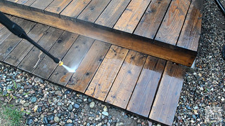 Cleaning wooden deck stairs with pressure washer | by yourbestdigs