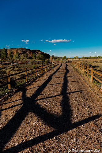 road leica blue light shadow sky cloud brown white newmexico color green texture lines fence landscape pattern desert outdoor path availablelight horizon perspective mesa bernalillo zajdowicz