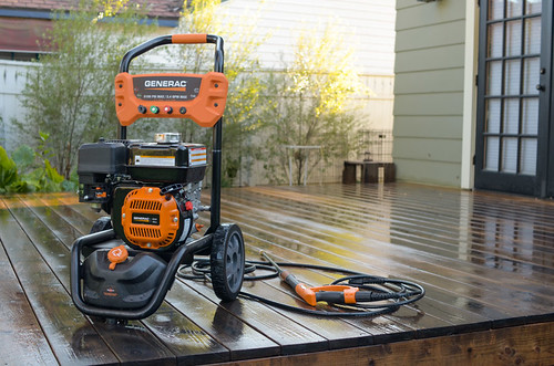 Gas pressure washer cleaning a wood deck | by yourbestdigs