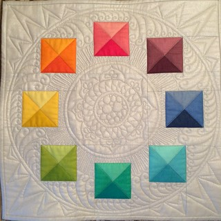 Finished mini quilt for the secret sewer swap at the Simply Solids Retreat.