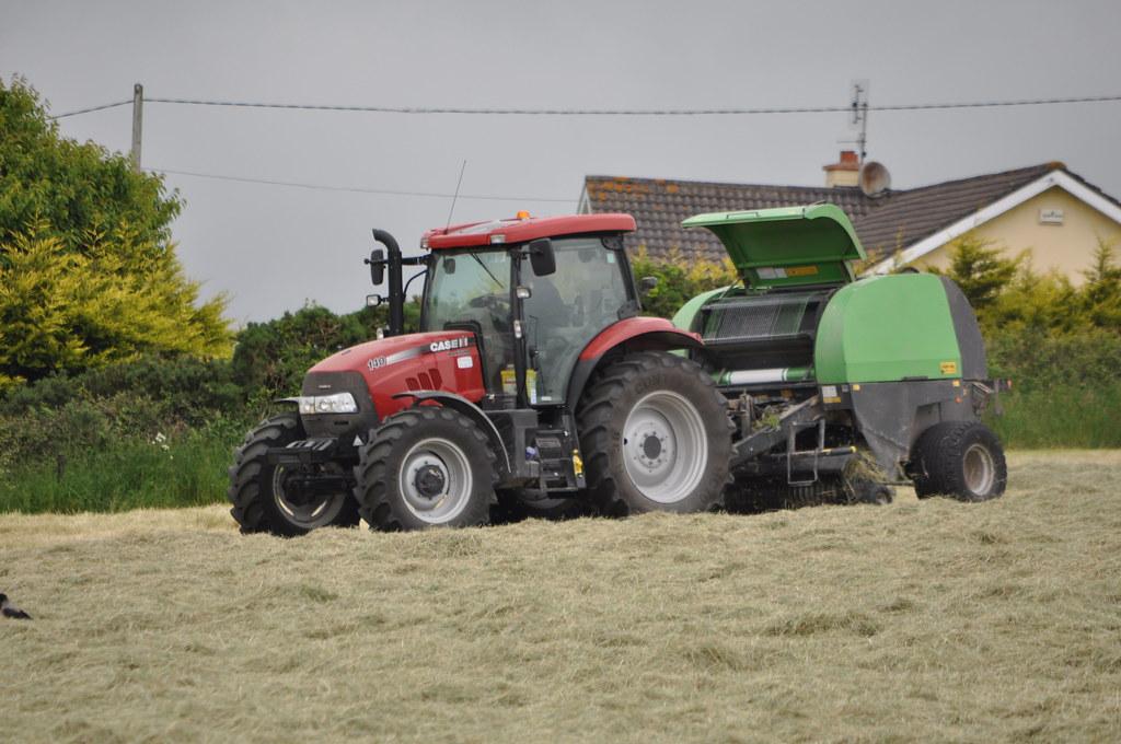 Case IH Maxxum 140 Tractor with a Deutz Fahr Round Baler