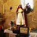 Imagen de Santa Tecla con exvotos dejados por fieles que han obtenido un favor por intercesión de la santa