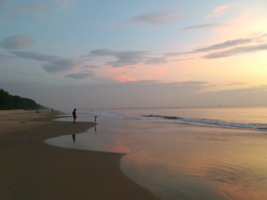 by Vikas Ravi with her grandpa at the beach!   by Vikas Ravi