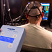 Electrodes administer transcranial direct current stimulation (tDCS) while sensors record oxygen levels in a test subject's brain as he performs a multitasking cognitive test in the Non-Invasive Brain Stimulation (NIBS) lab at the Air Force Research Laboratory, Wright Patterson Air Force Base, Ohio, July 19, 2016. Researchers working in the NIBS lab, led by Dr. Richard A. McKinley, Ph.D., are exploring how tDCS of the human brain affects cognition, fatigue, mood and other areas with the end goal of improving warfighter awareness, memory and focus. (U.S. Air Force photo by J.M. Eddins Jr.)