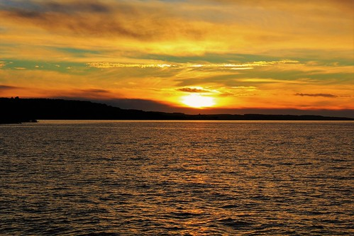 sunset sundown dusk gold golden goldenhour lake harbor lakemichigan petoskeyharbor reflection clouds backlitclouds backlight autumn petoskey michigan jannagalski jannagal colorful