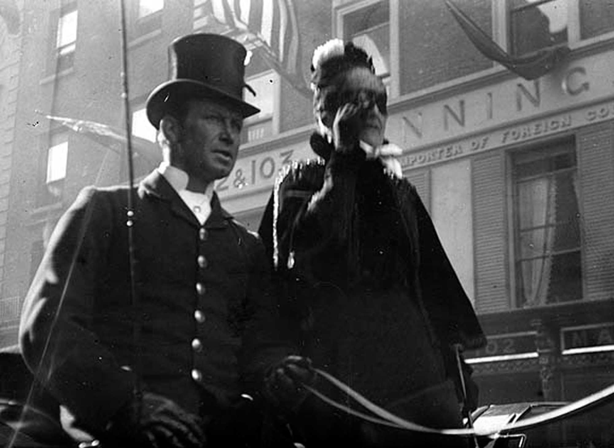 Man and woman in vehicle passing 102-103 Grafton Street