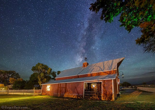Country barn under starry night sky